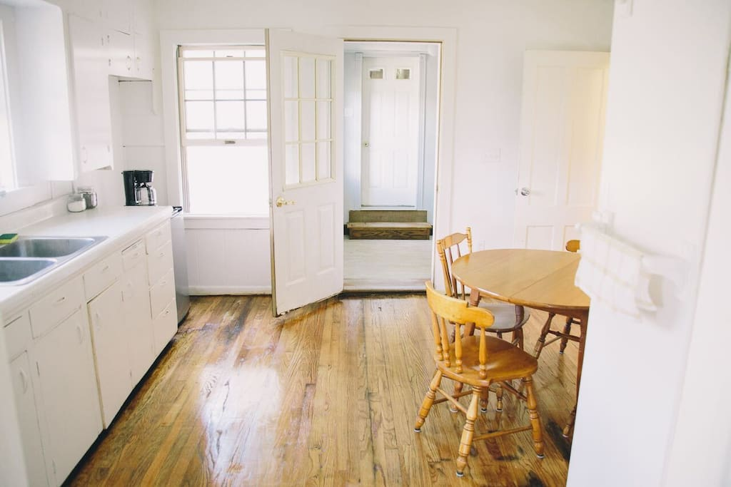 Quaint simple kitchen with large refrigerator & stove