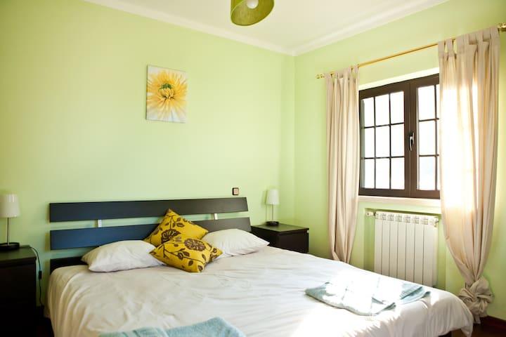 Green double ensuite bedroom (downstairs)