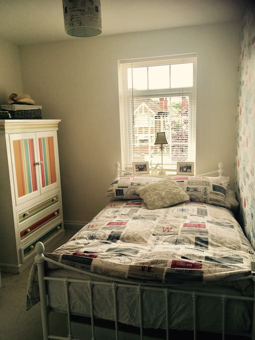 Small double bed & guest wardrobe
