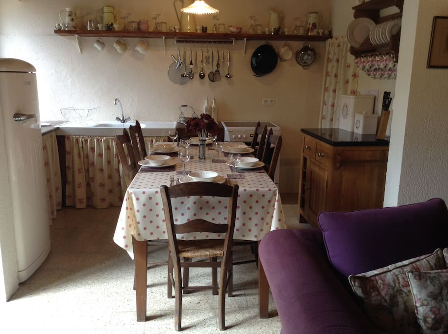 Fully equipped kitchen/dining area with microwave, fridge/freezer, cooker, washing machine.