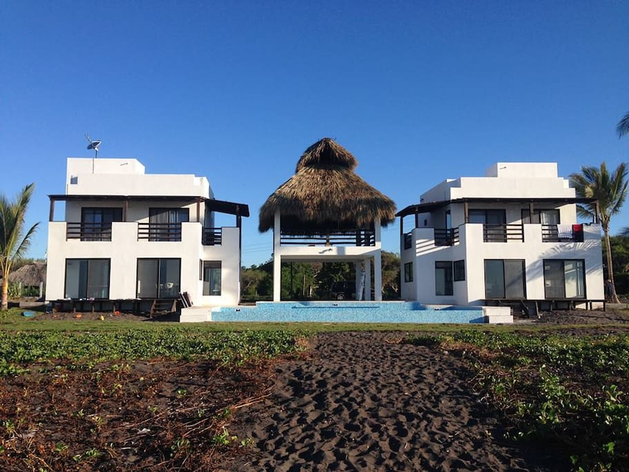 2 Brand new beach-front villas - up to 10 persons in each villa. Can be rented seperately or together for up to 20 persons. 2-story thatched rancho and large infinity pool shared by the 2 villas.