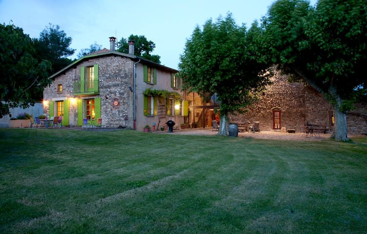 The house is located on 15 acres of private land with a fruit orchard and a vegetable garden