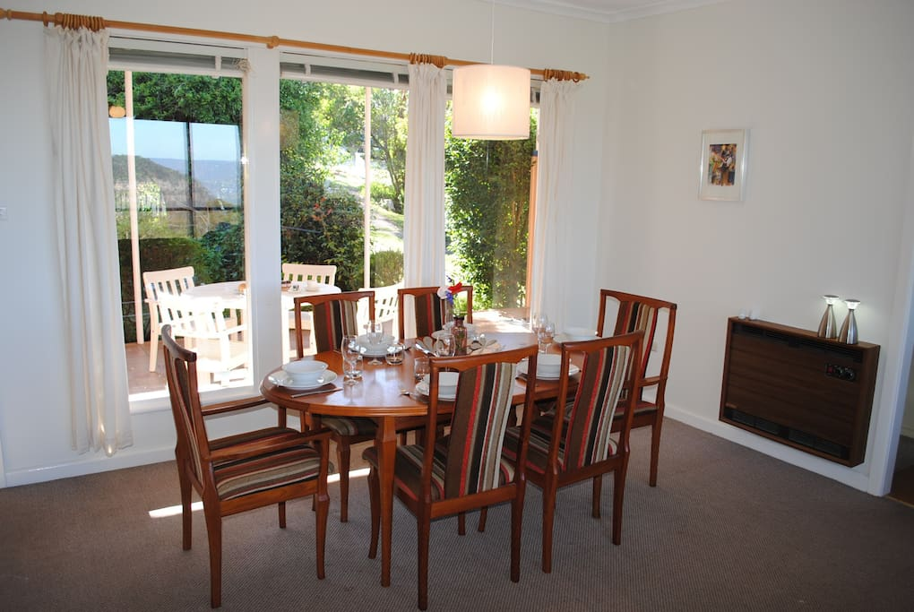 Modern, well equipped dining setting overlooking the garden.