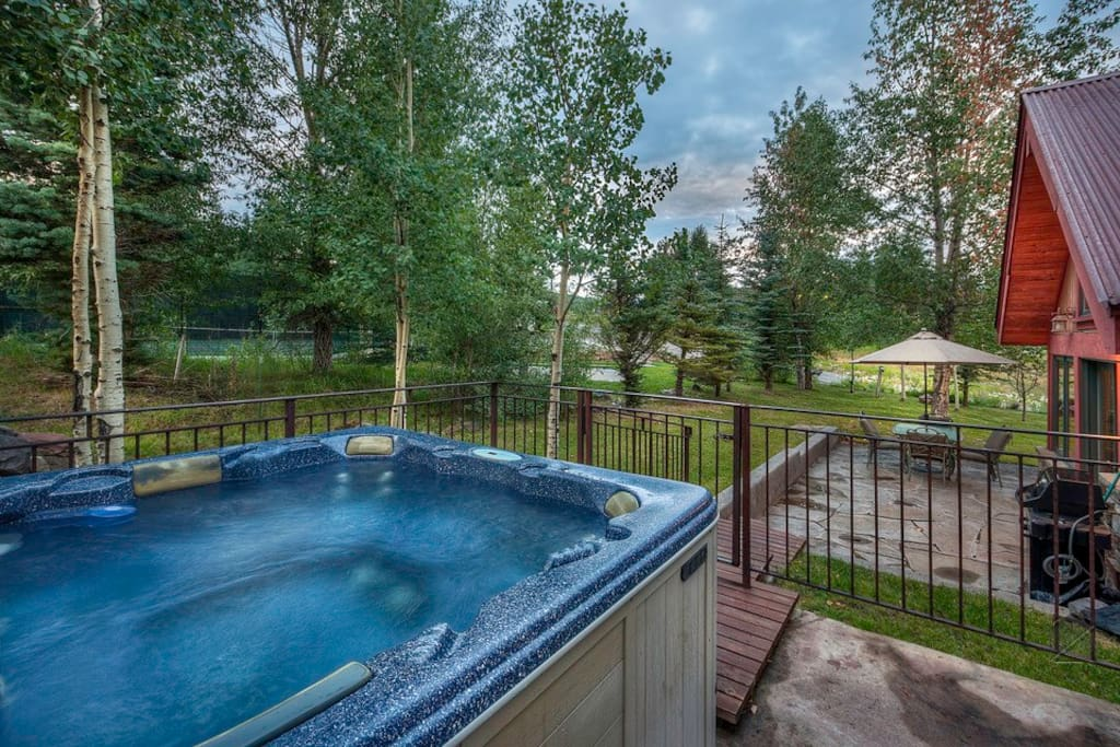 Rest your sore muscles with a soak in the private outdoor hot tub off of the living room/dining room.