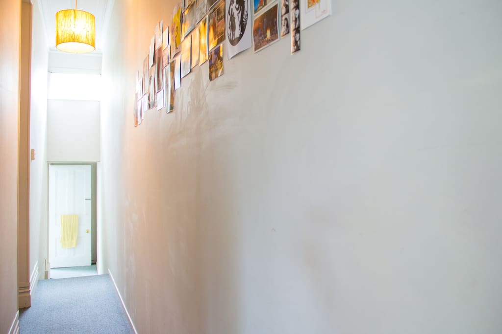 Our long hallway decorated with postcards from visitors