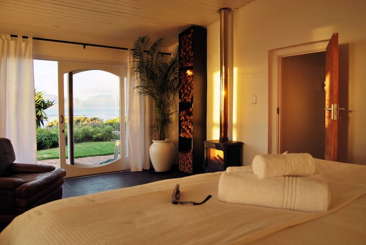 Master bedroom with fire place & sea and mountain views