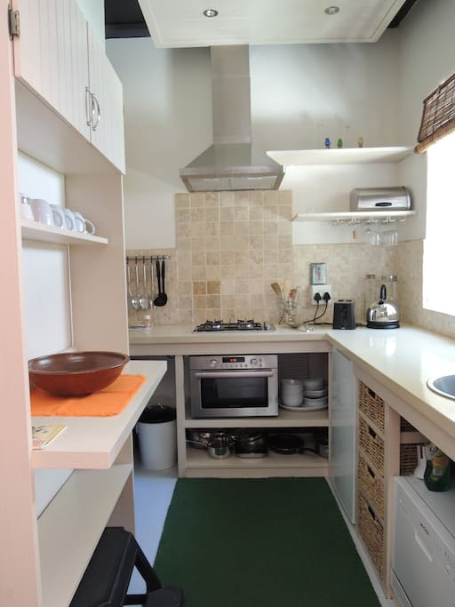 The apartment has fully a equipped compact kitchen. There is even a compact dishwasher!