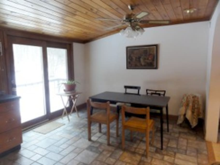 The dining area is part of the kitchen, near the door to the back deck.
