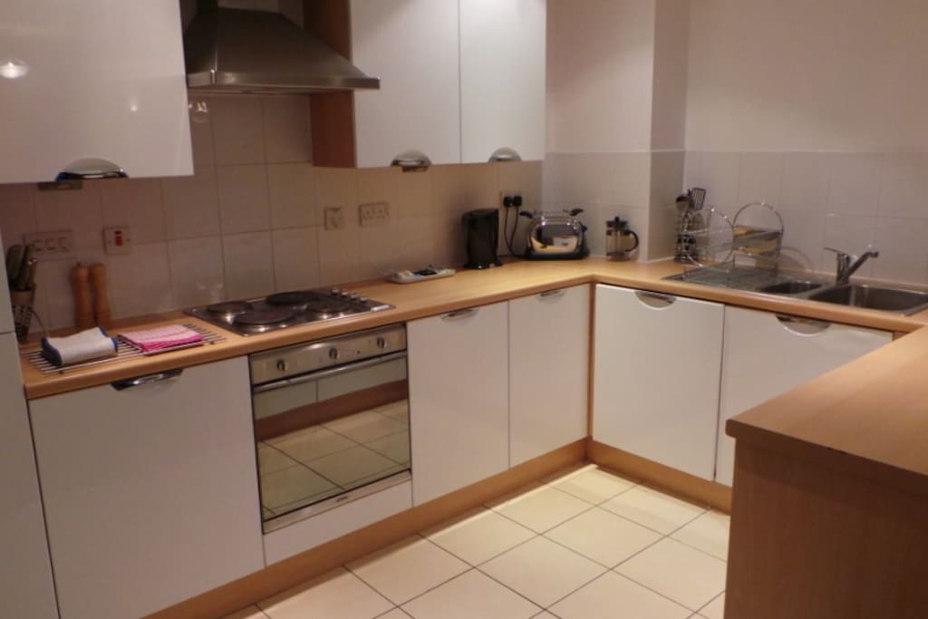 Kitchen - fully equipped with pots, pans, plates and cups