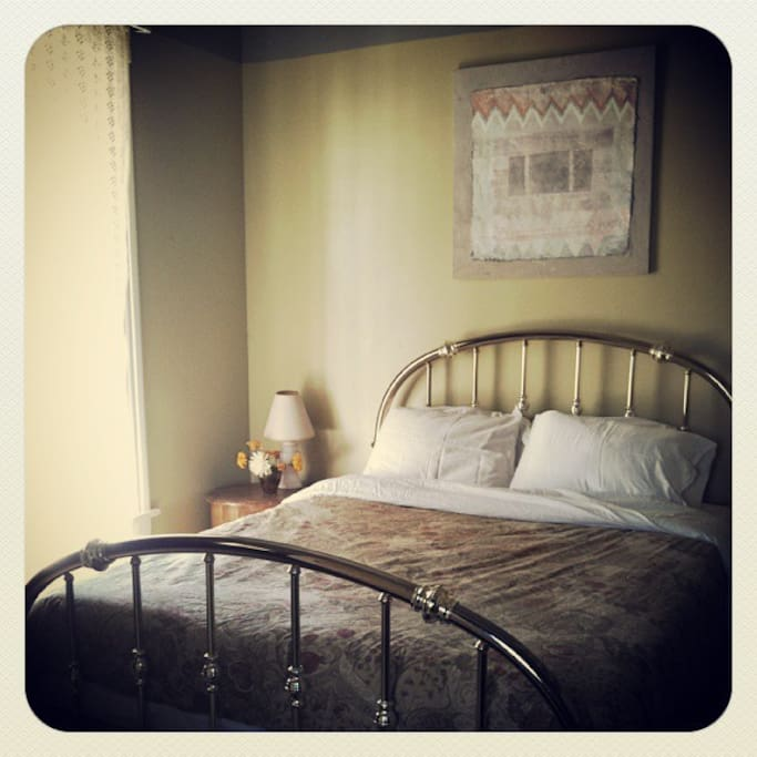 The queen bed in our Redwood Room. Made with all organic cotton sheets and Kapok pillows.