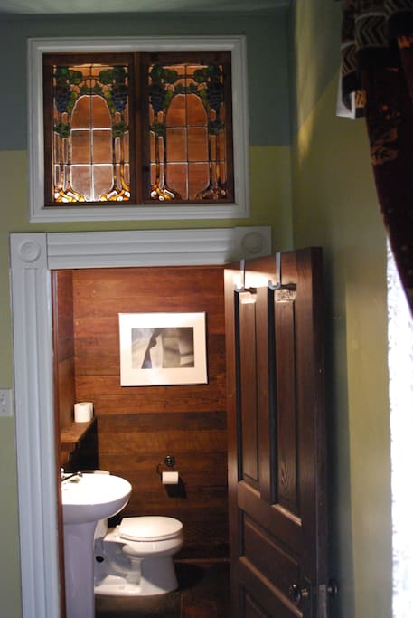 The Redwood Room is the only room that has its own private half-bathroom.