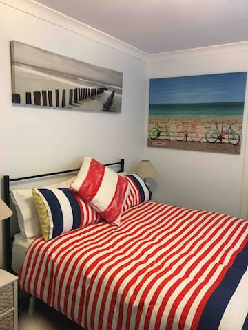 Very comfortable queen sized bed, flat screen TV and DVD player, portable oil heater, pedestal fan, wardrobe, plenty of hangers, luggage rack, full length mirror.