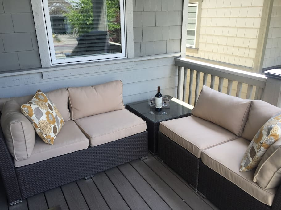 Cozy front porch to enjoy a glass of wine and cook on the gas BBQ