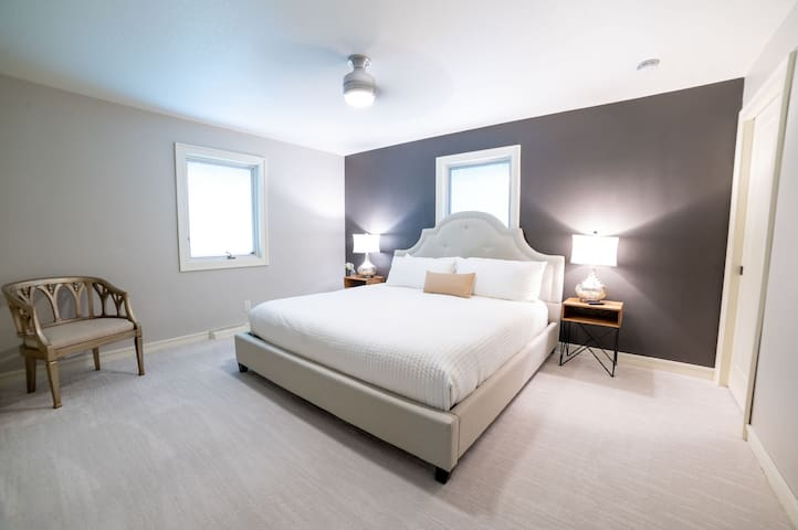 """Master bedroom with a king bed to sink into! New mattress and bedding! This comfy and cozy space provides a great place to rest or catch up on tv (50"""" smart tv). Private master bathroom with marble tile, bathtub, and shower."""