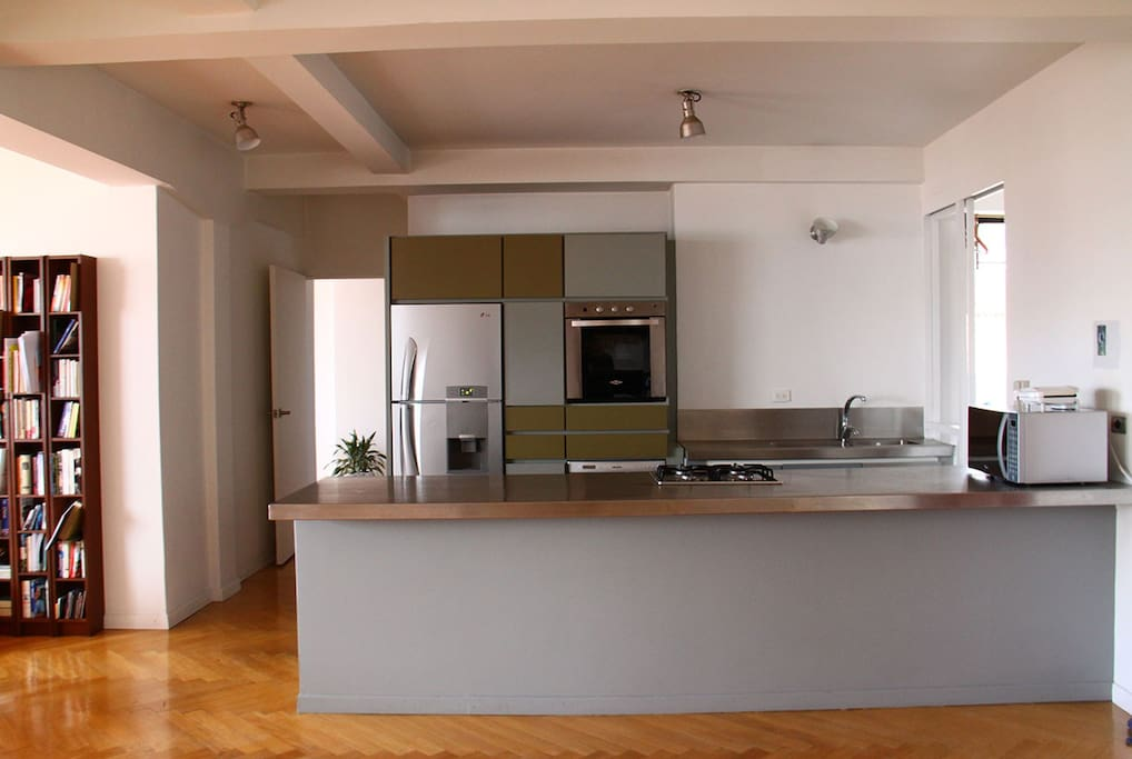 Open, modern, fully equipped kitchen.
