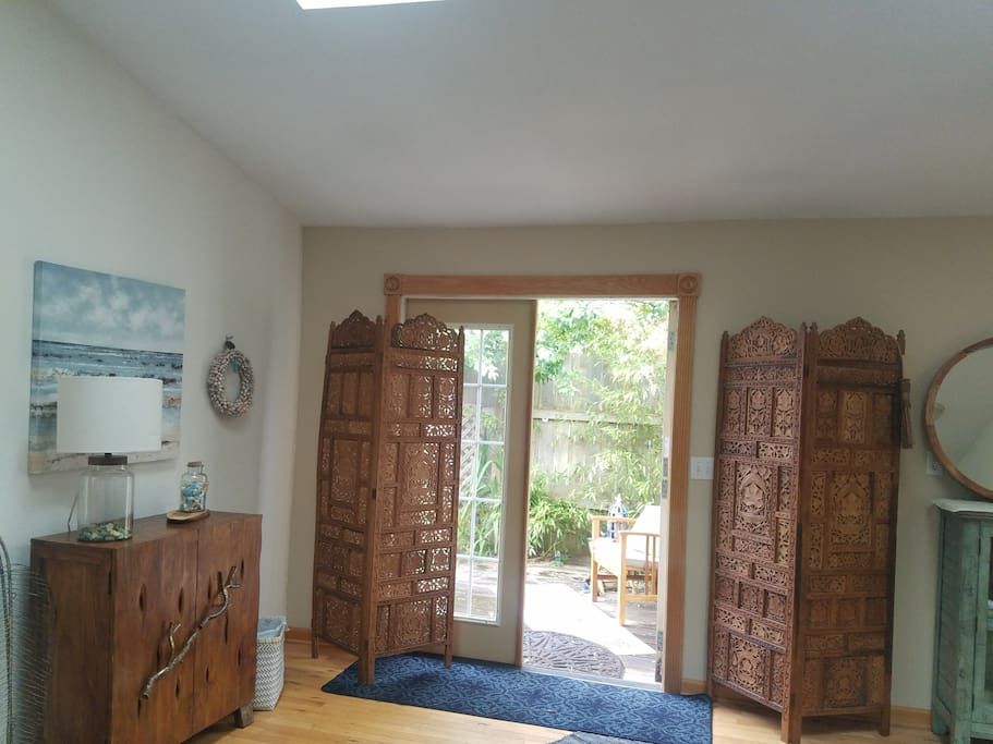 French doors to patio. Cupboard with boards games, etc.