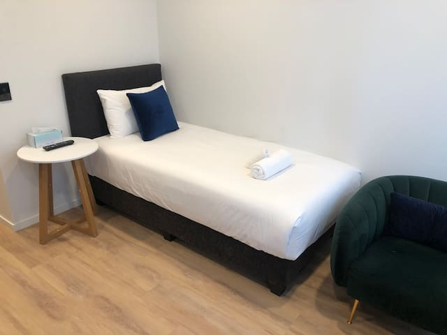 Single bed with 55 inches smart TV