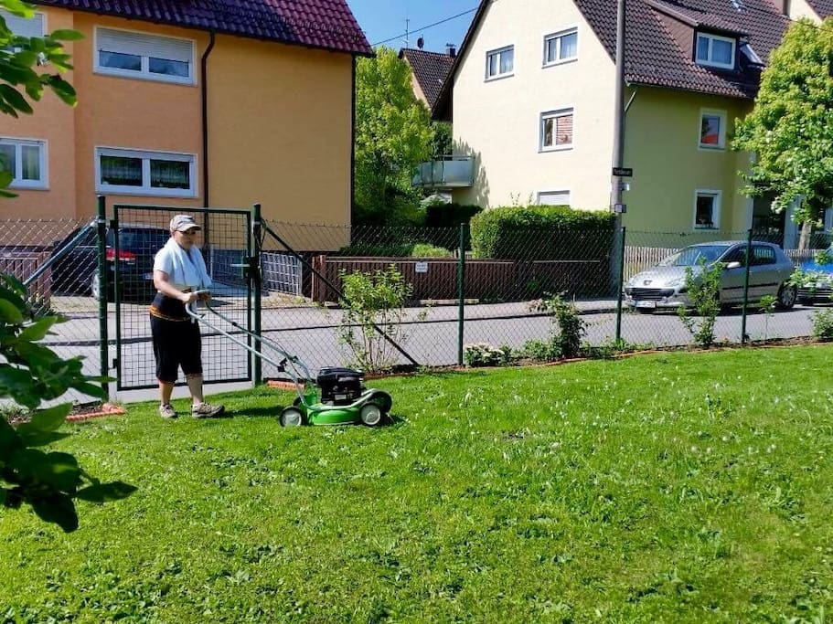me, busy mowing the lawn in our 2nd garden, behind me Chrissi's apartment on the 1st floor.