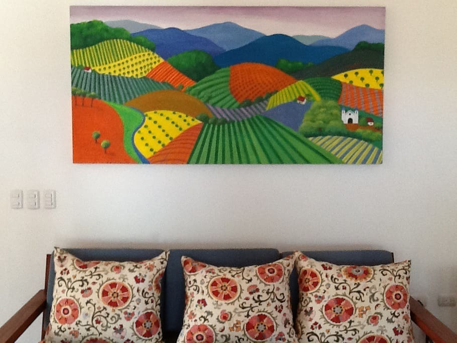 Vibrant fabrics and colorful art in public areas add pops of color.