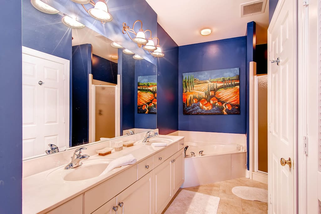 The master bathroom (#1) features a large soaking tub, Separate shower, and double vanity.