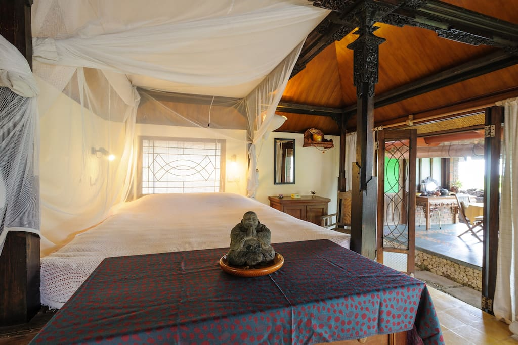 Bed has mosquito net and fans, room has a wooden chest of drawers and cupboard for storage (plenty of room for your suitcases under the bed)
