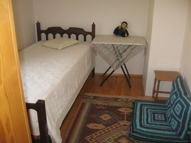 First room on the first floor, with a single bed and a wardrobe.