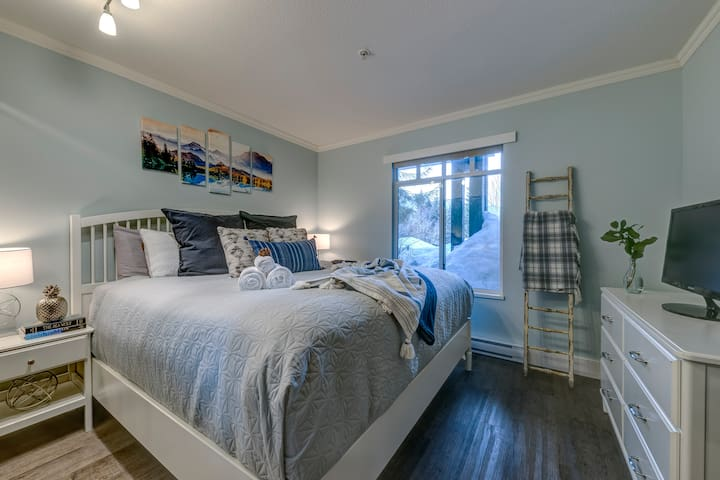 The master bedroom features a queen bed with flatscreen tv