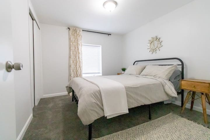 Second bedroom with a queen-size memory foam mattress and lots of natural light!
