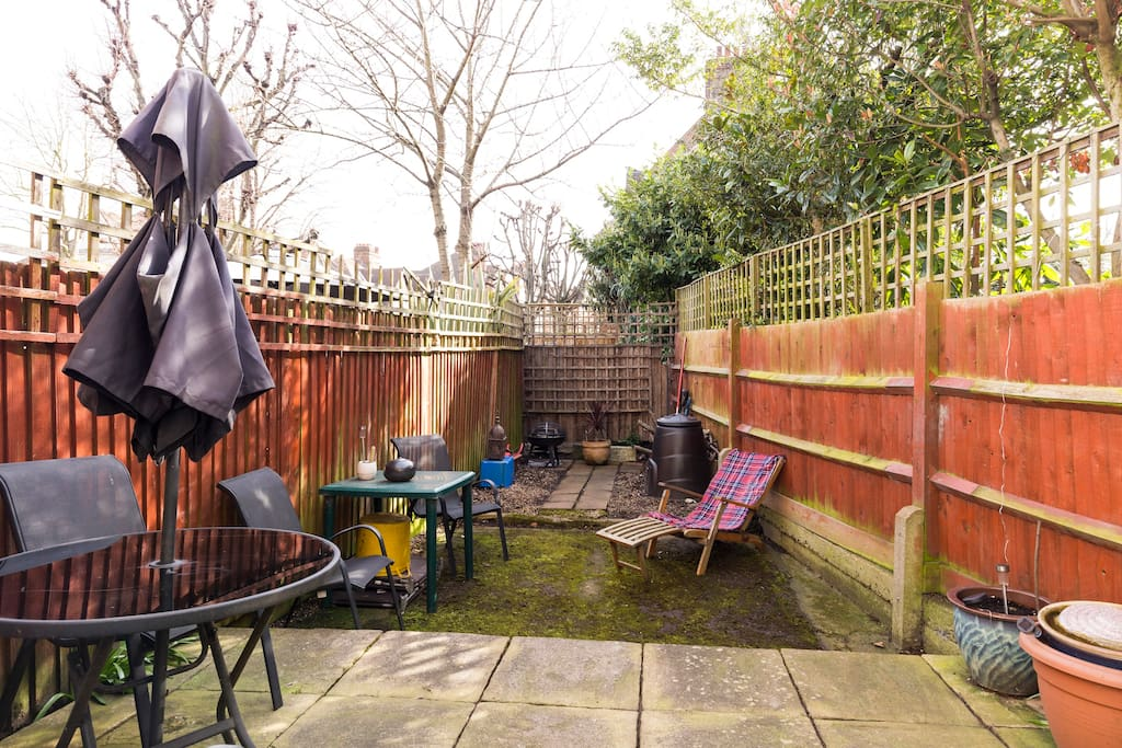 Private rear garden.  Perfect for BBQs, sunbathing, a cheeky smoke(!) and some peace from the bustle of London.