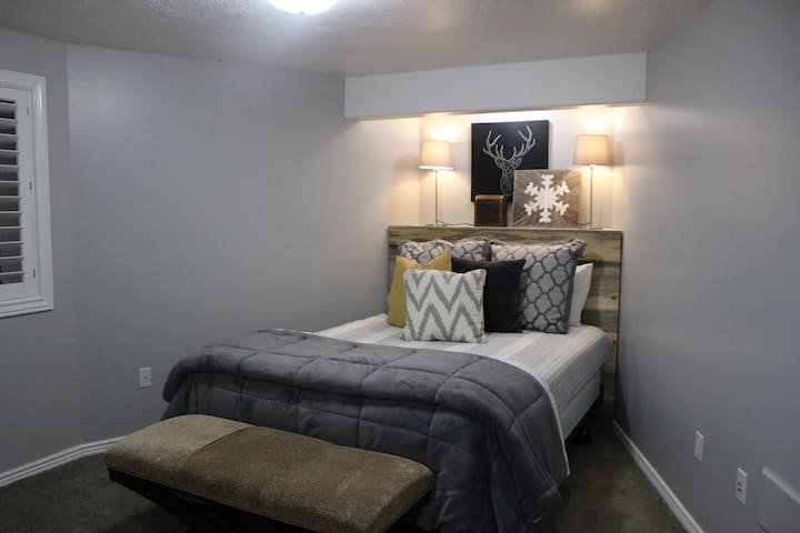A queen size bed with a big closet and TV. Plenty of outlets for charging electronics.