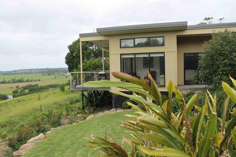 Flame Tree villa sits amongst gardens overlooking paddocks.