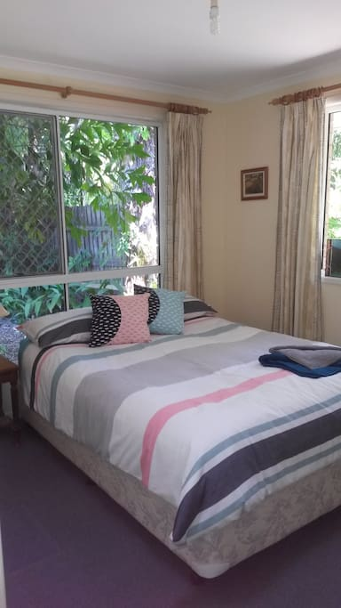 Queen size bed with innerspring for a good nights sleep surrounded by shady trees.  Very private.  This is Bedroom 1