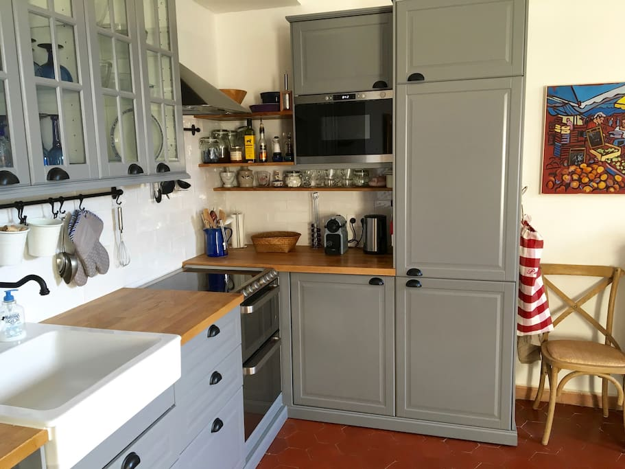 The kitchen has been completely re-done and features a harvest sink, fridge, freezer, 4 burner induction stove, convection oven, microwave, Nespresso machine and a dishwasher.