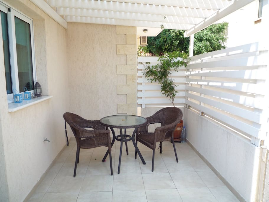 Rear Secluded Patio. Ideal for Al Fresco Dining or perhaps a glass of wine with friends!