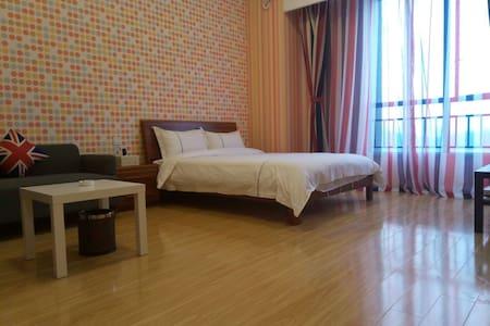 广州萝岗科学城演艺中心旁边主题公寓 - Guangzhou - Huoneisto