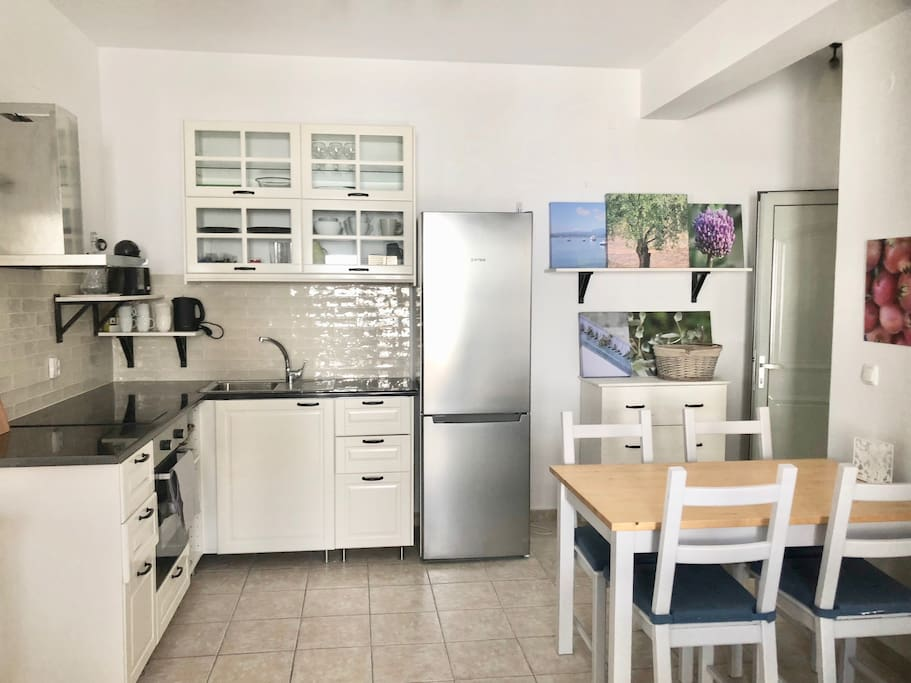 Fully Equipped Kitchen with coffee machine and utensils for cooking