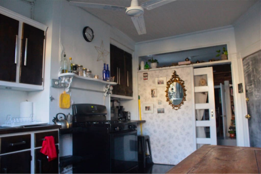 Kitchen with basic cooking needs for guest .  Coffee maker , toaster , tea pot etc