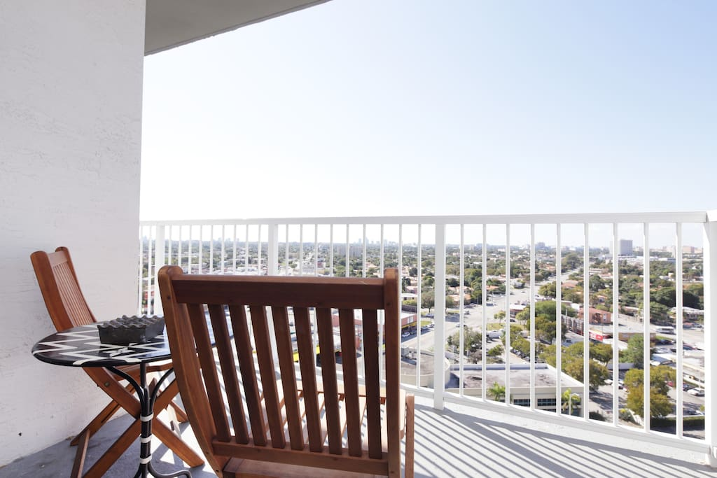 The balcony: Stunning view of Coral Gables, Coconut Grove and Biscayne Bay, perfect to treat yourself to a cup of tea watching the sun going down or up.