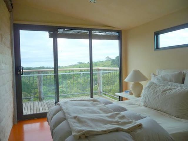 Bedroom and balcony with double glazed window ocean view