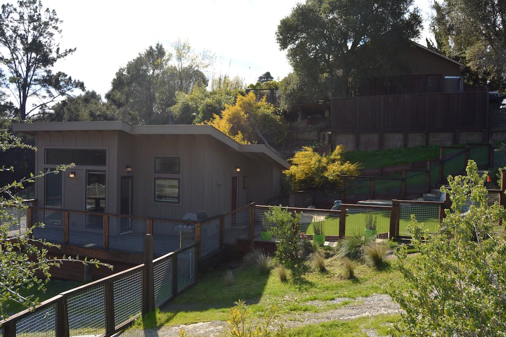 Side view of guest house with BBQ