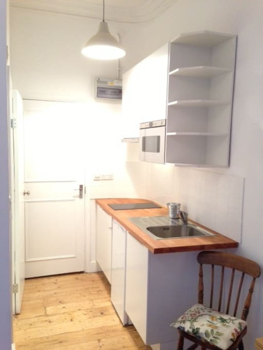 Neat kitchenette with ample storage.