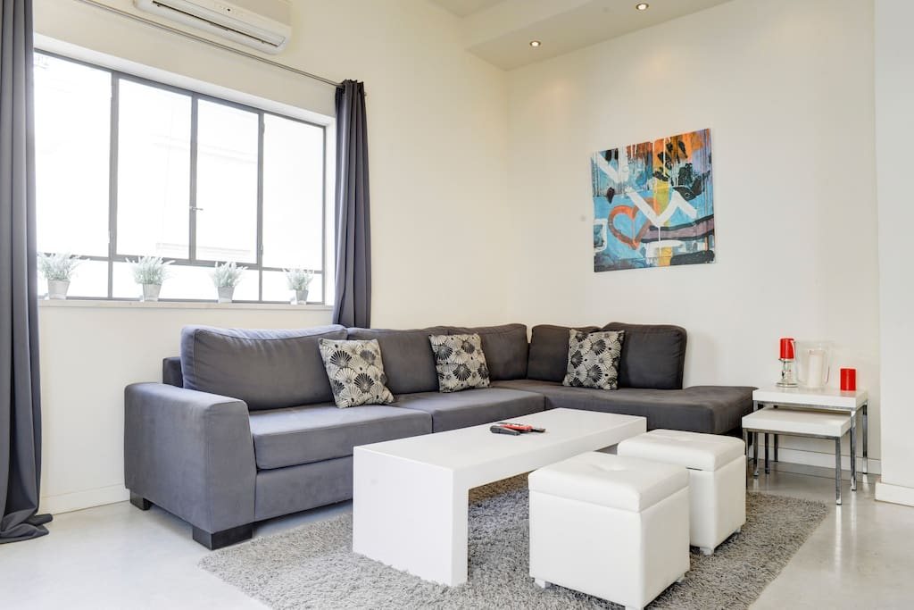 nice and bright living room where you can sit and relax over a great book or movie in the cable tv