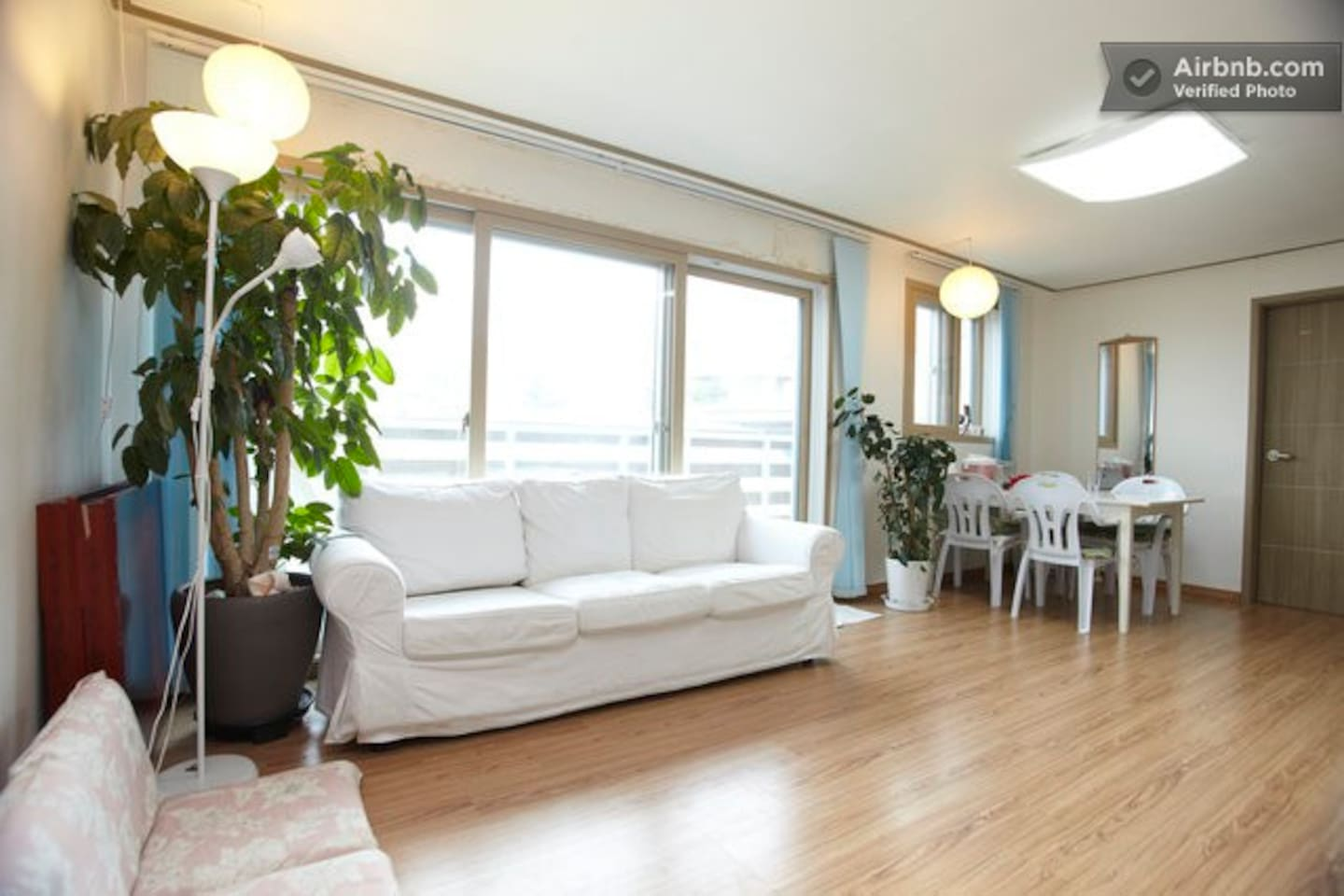 Relaxing open living area with a lot of natural light and great view of Seoul Tower.