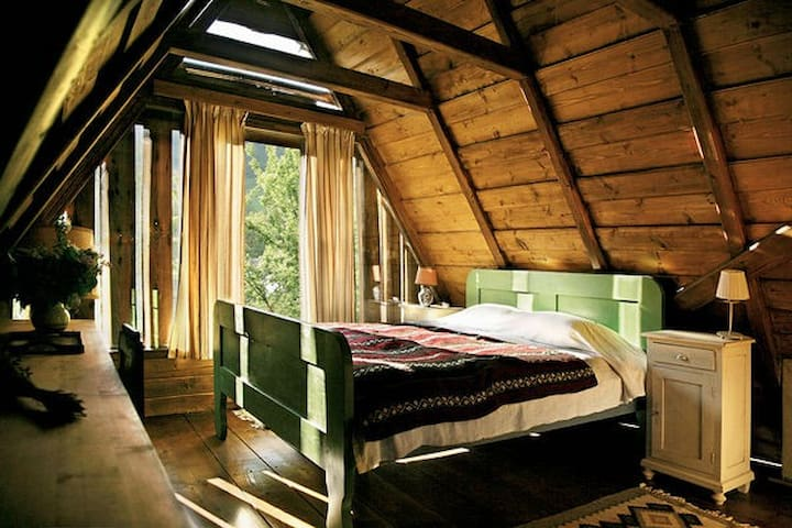 Matrimonial loft bedroom, private bathroom with bath tub