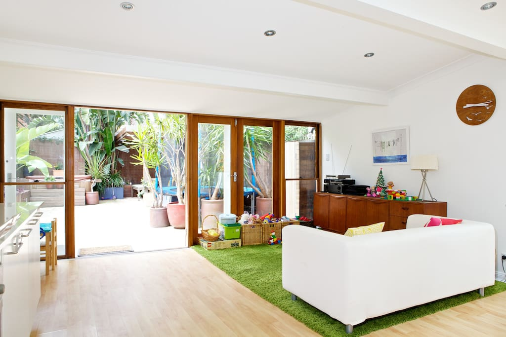Large kitchen / family / dining: Children's play zone, opens directly to rear garden