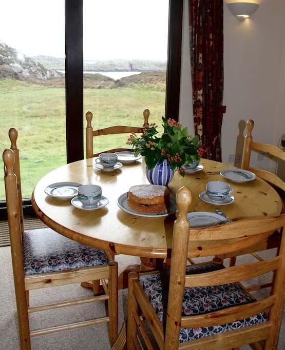 Open plan lounge and dining area - watch the ever-changing Assynt landscape as you enjoy your supper