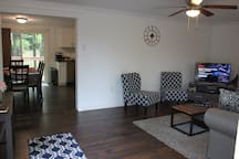 Living room and dining room. Gather the family and sign into Netflix/Hulu/Prime Video or choose from many cable channels.