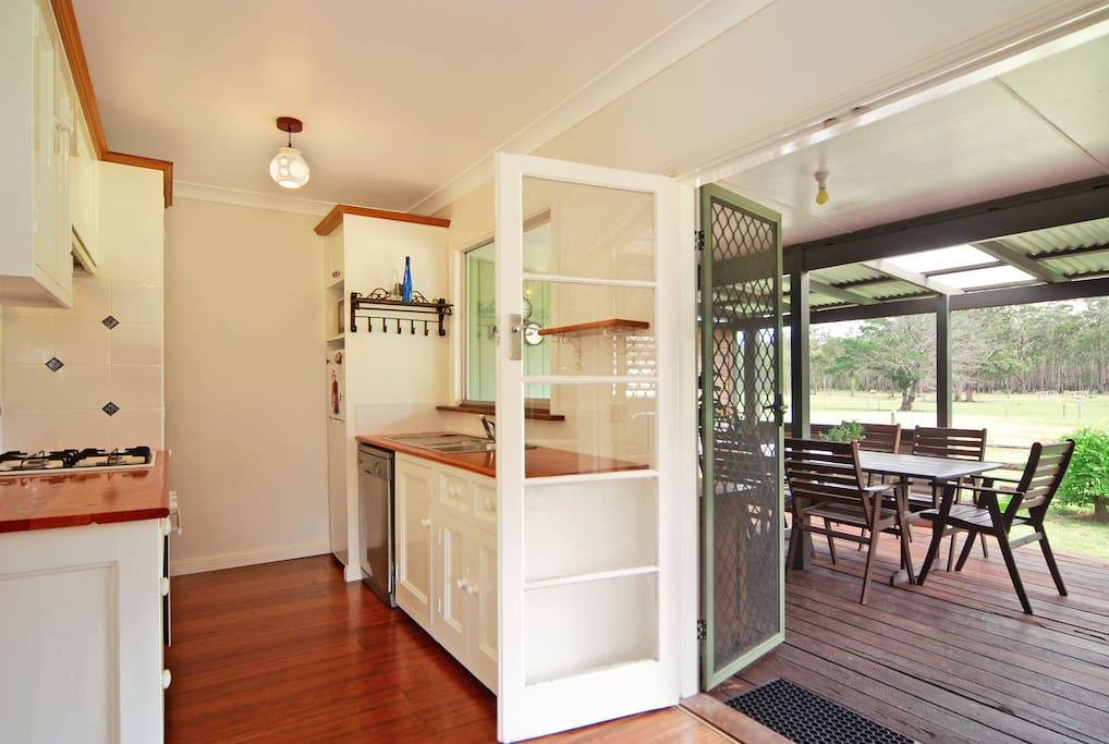Country-style kitchen opens onto the large deck.