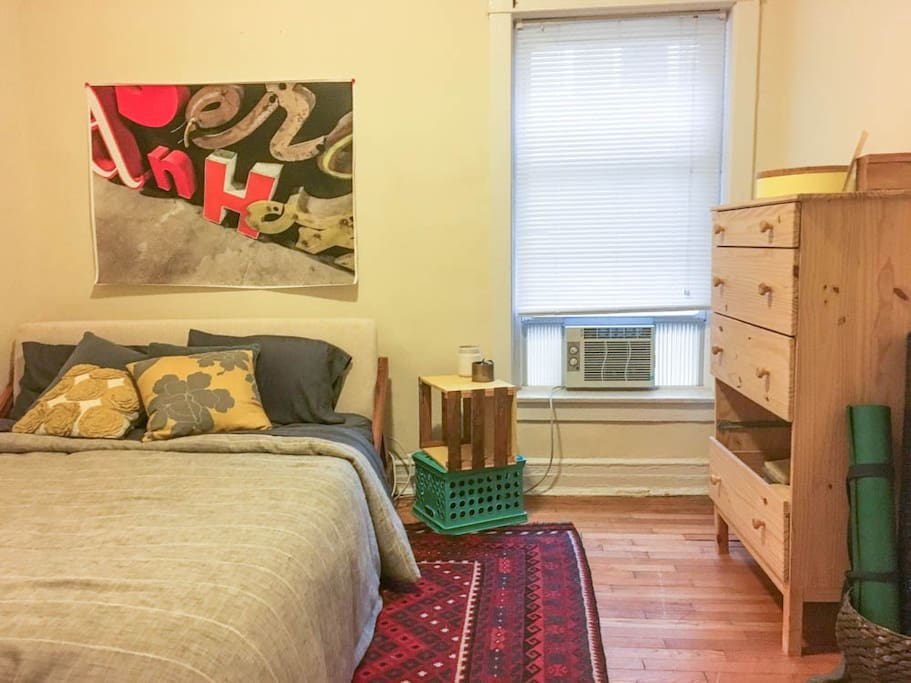 Air conditioned bedroom with queen sized bed