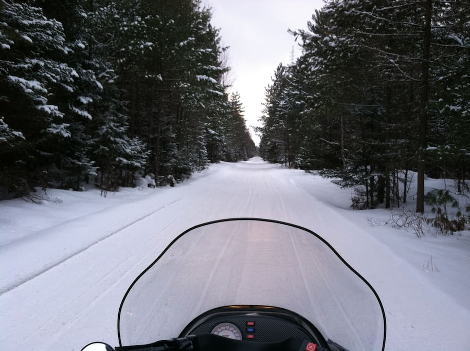 Right on some of the best snowmobiling trails in the world.